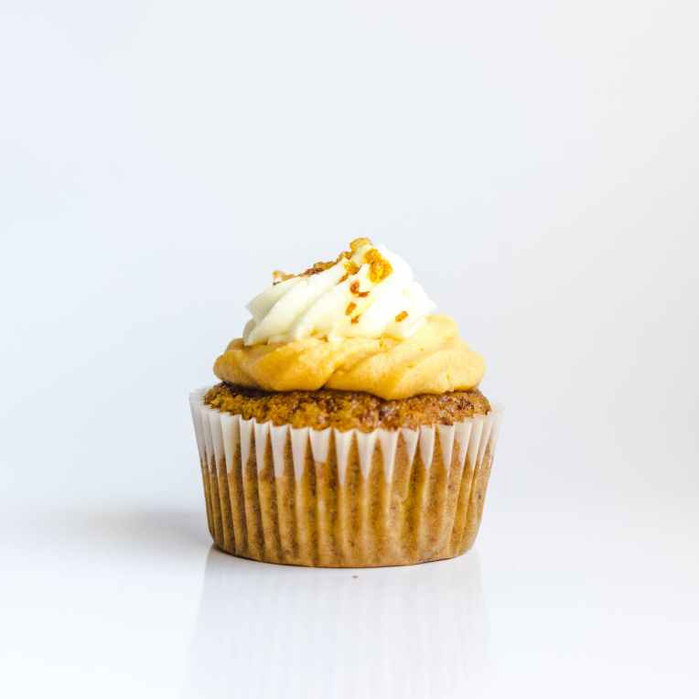cupcake topped with white frosting